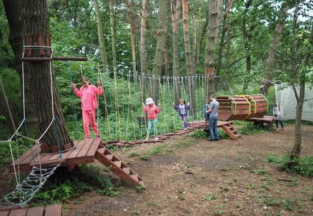 Children in the Rope Park at BEAR SANCTUARY Domazhyr