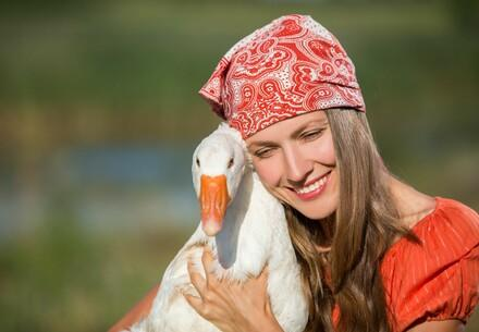 Woman holding a goose