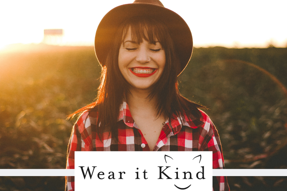 "Woman wearing animal-friendly clothes with ""Wear It Kind"" logo in the middle"