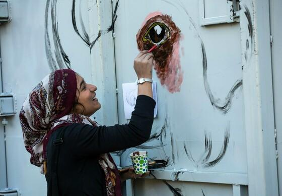 Artist, Shimza Kamal, paints on the transport crate of elephant Kaavan in Marghazar Zoo
