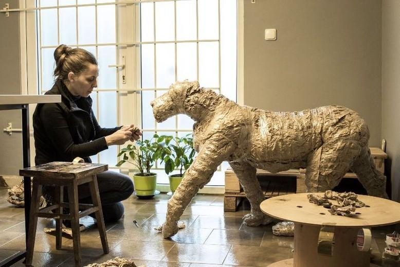 lion-from-paper-woman-flowers-windows-room