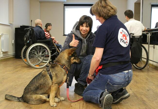 "Dog Busia at the AAI therapy session at the new AAI ""Harmony Center"" in Vinnytsia, Ukraine."