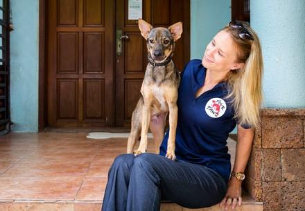 Veterinarian Dr Katherine Polak with Sopol, a dog rescued from the meat trade by FOUR PAWS