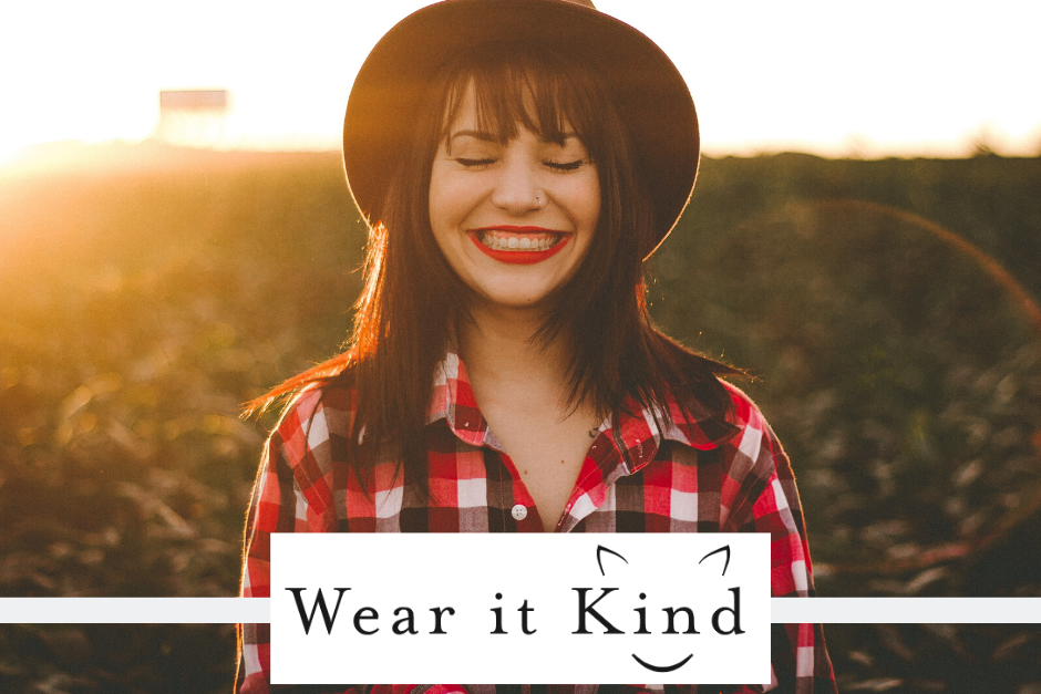 Smiling woman with wear it kind logo