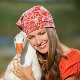 Woman hugging a goose